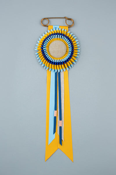 Navy, yellow and light blue rosette