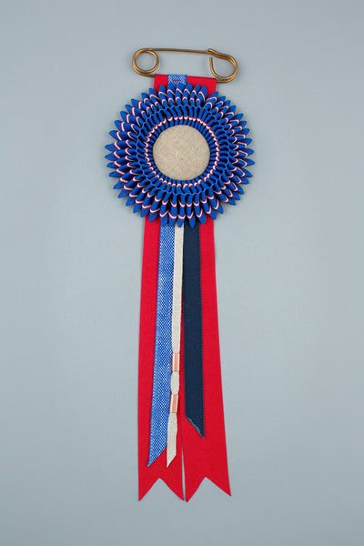 Blue, red and white stripe rosette