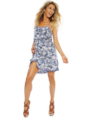Flowy dress with ruffles on top and skirt and elastic waistline that gives a flexible fit. Decorative pom-pom details on both the top and along the hem line.