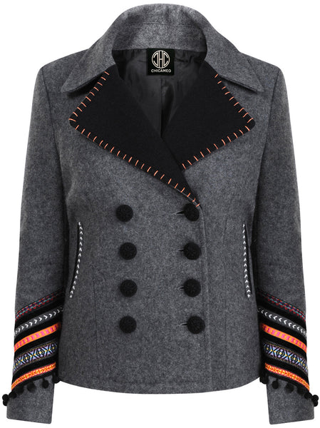 Wool-mix jacket with a soft hand-feel and good structure. Diagonal large cuffs on both sleeves with colourful trims and pom-poms as well as hand-stitching on front collar.