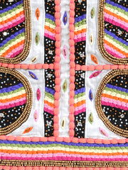 Hand embroidered skirt with beads in different shapes and metal-tones mixed with rainbow coloured pom-poms.