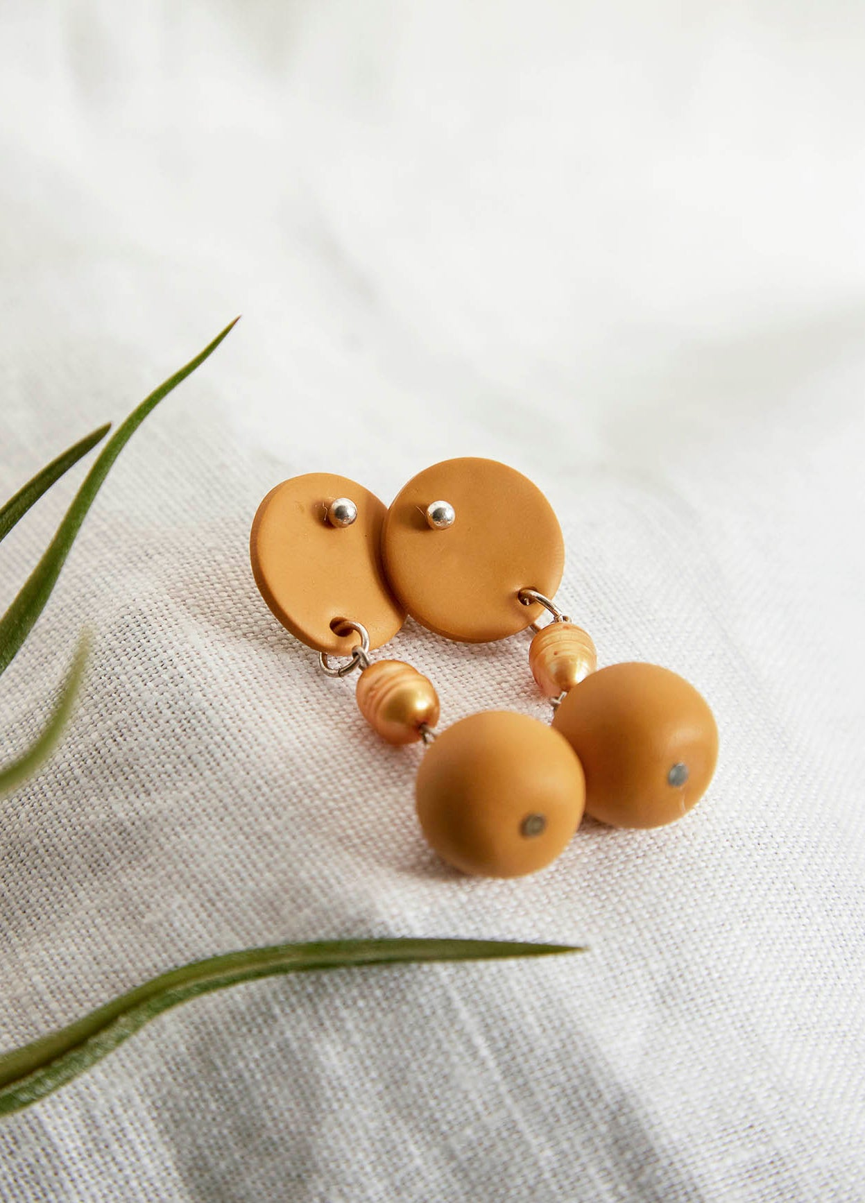 Surface Single Pearl Earrings
