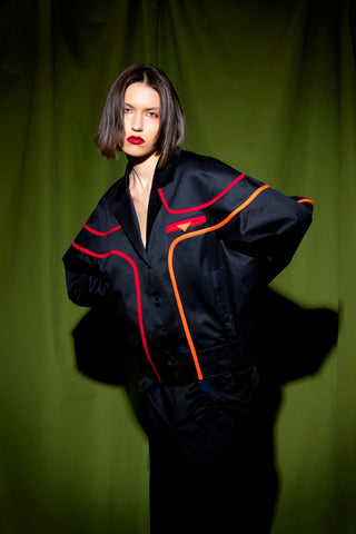 black bomber jacket with red neon stripes