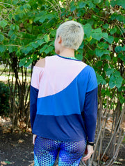 Kinetic Tee pdf sewing pattern - athlete model wearing a colourblock version of View C, back