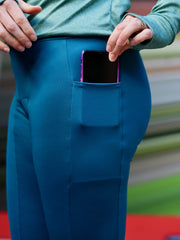 Rouleur Leggings View A - closeup of side panel leggings pocket with phone emerging