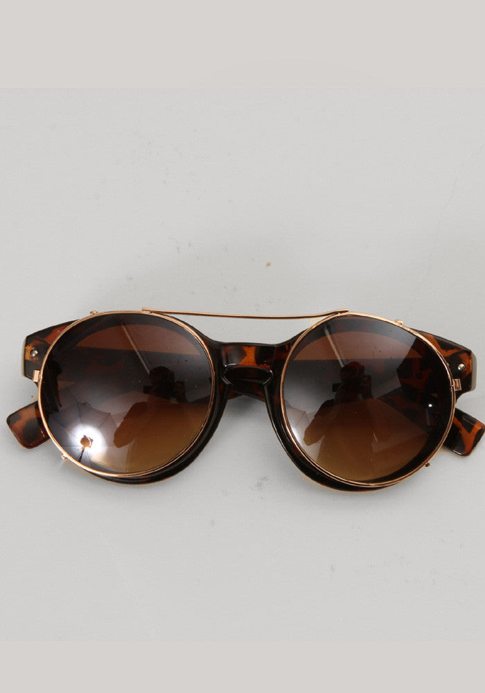 Tortoise brown round sunglasses with metal clips