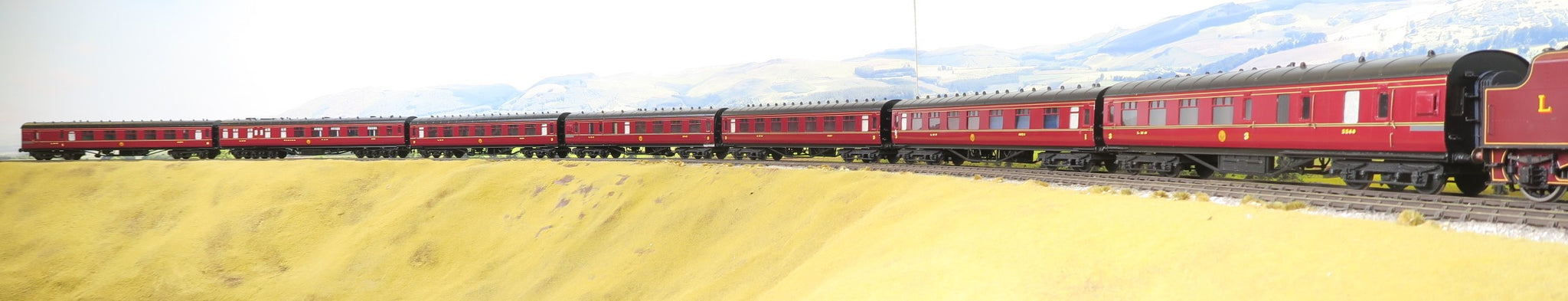 7mm Finescale O Gauge Kit Built Rake of 7 LMS Lined Maroon Passenger Coaches