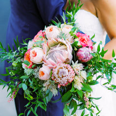 sarah sam wedding wildflora blue peach pink magenta flowers floral bridal bouquet wedding bride