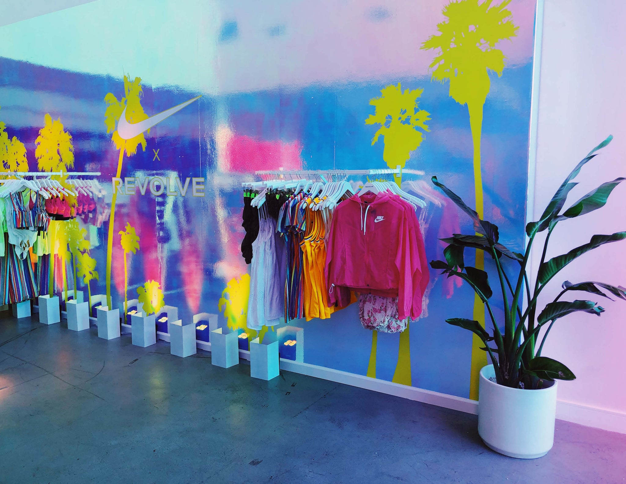 © Wildflora 2019 Nike x Revolve Pop-Up Event Los Angeles florist Ventura Blvd Studio City California Original Farmers Market The Grove delivery floral bloom plant arrangement color palette pastel light pale pink blue green purple neon Lisa Frank yellow chartreuse tree white ceramic custom ceramic planter pot container clothes display palm tree bright fun alive cute hipster active-wear leisure-wear temporary jacket display shop sports bras bird of paradise floor