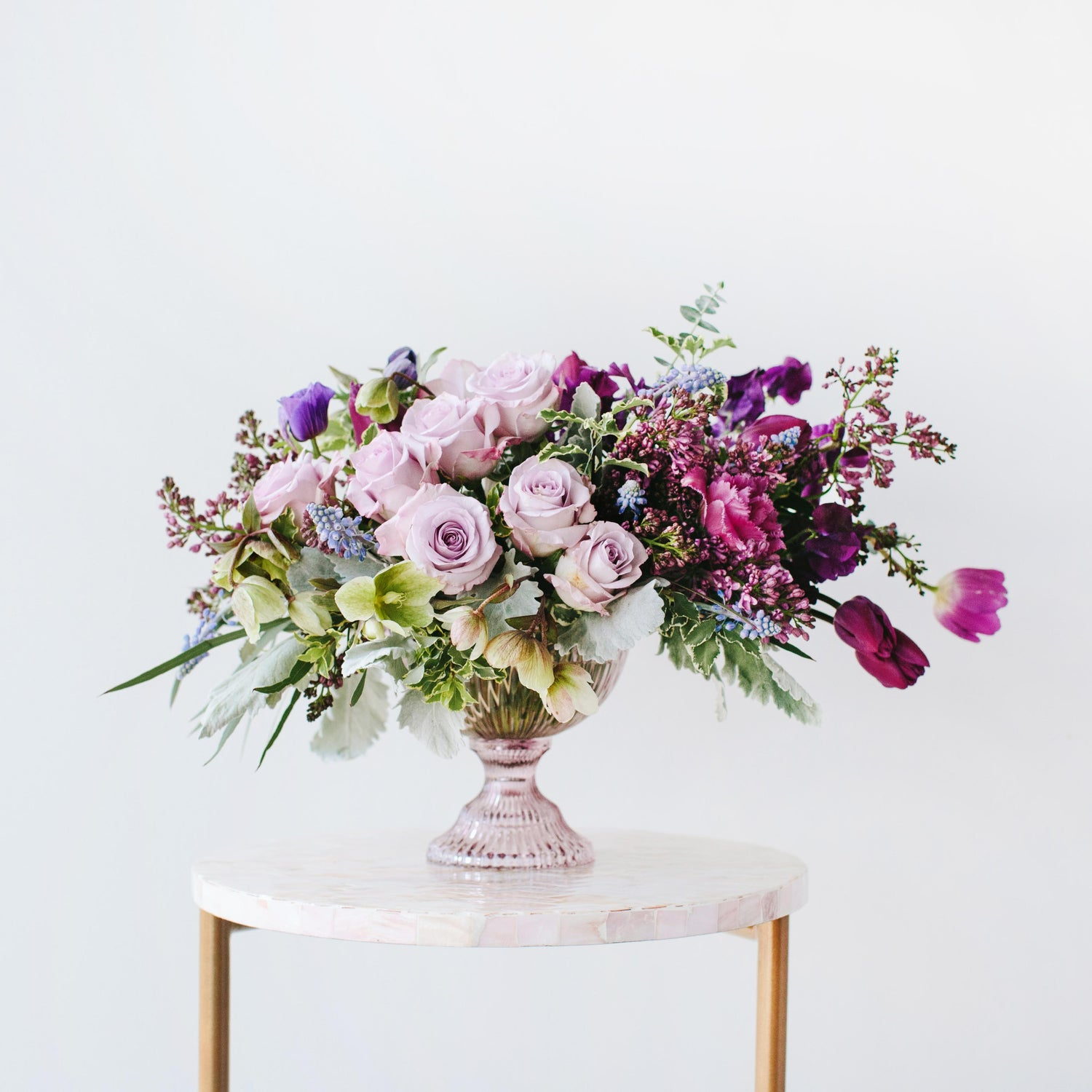 Wildflora Los Angeles florist Ventura Blvd Studio City flower bouquet floral arrangement wedding event special occasion shop store Eucalyptus green foliage dusty miller aubergine eggplant purple lilac lavender rose pale light hellebore sweet pea glass urn pink table