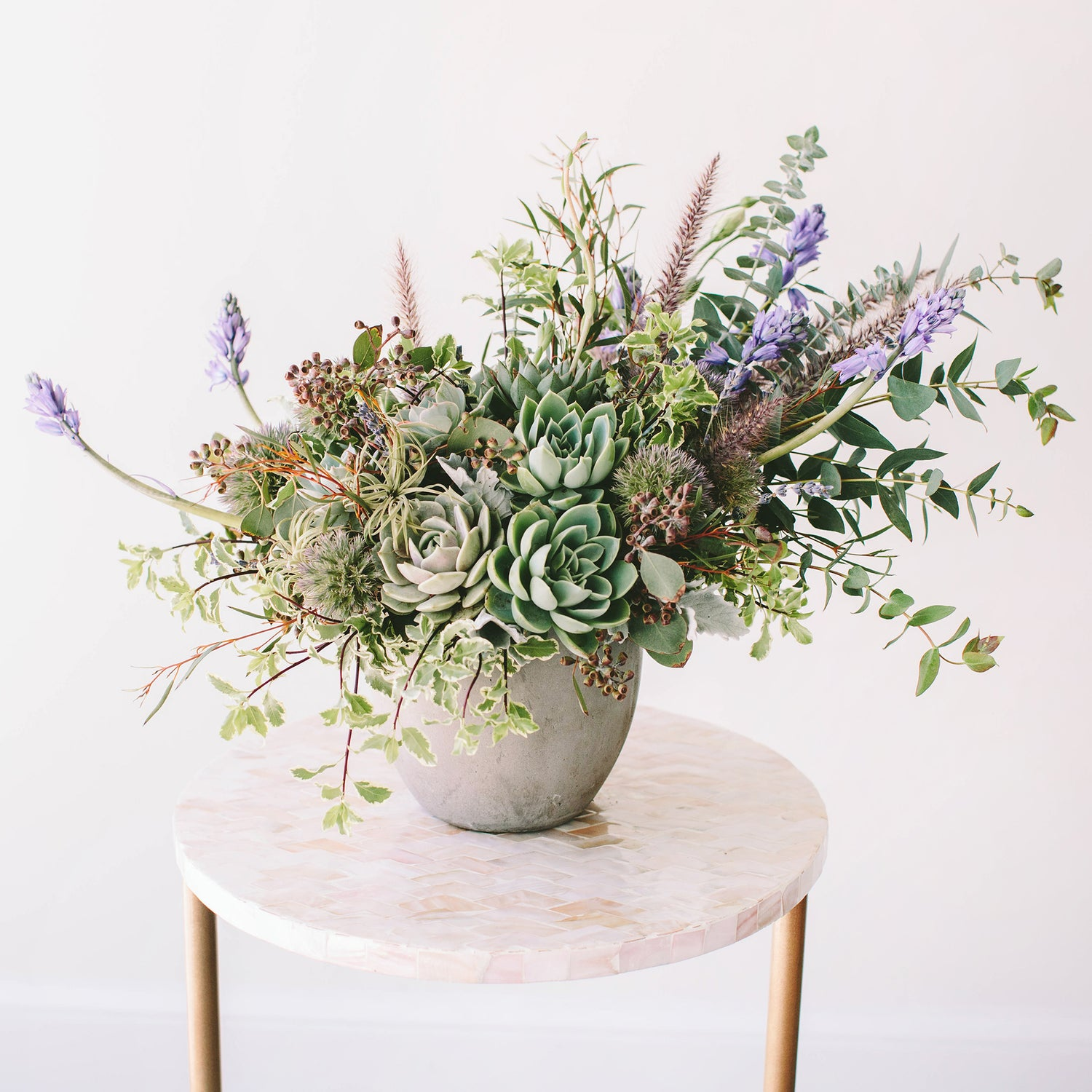 Wildflora Los Angeles florist Ventura Blvd Studio City flower bouquet floral arrangement wedding event special occasion shop store Eucalyptus green foliage variegated dusty miller hyacinth grass frond plume succulents grey gray blue table