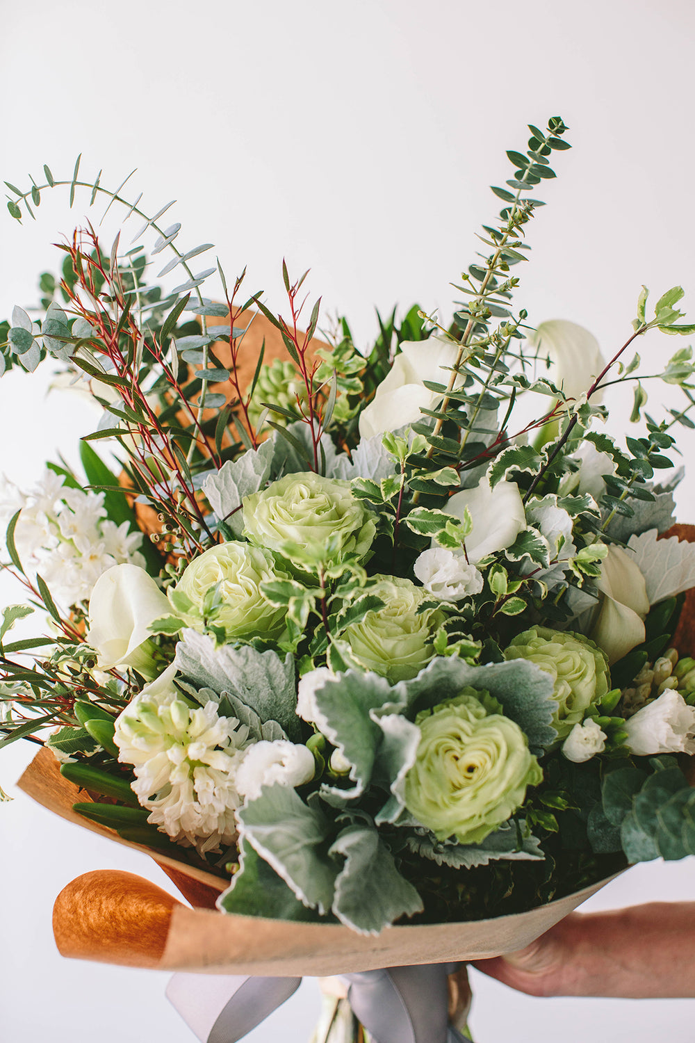 verde variety green Wildflora Los Angeles florist Ventura Blvd Studio City flower bouquet floral arrangement wedding event special occasion shop store Eucalyptus green foliage rose white leaf leaves rose light pale dusty miller brown paper wrap grey ribbon variegated hyacinth calla lily