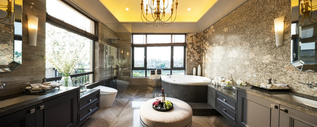 bathroom featuring a chandelier and wall lights