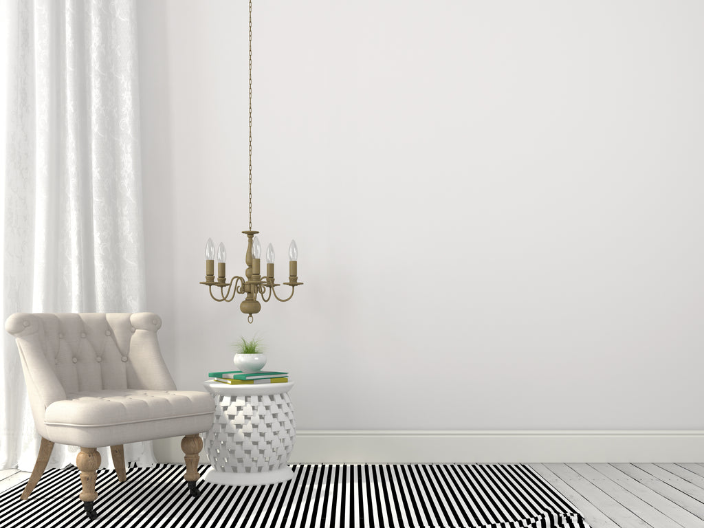 Low offset small chandelier over side table