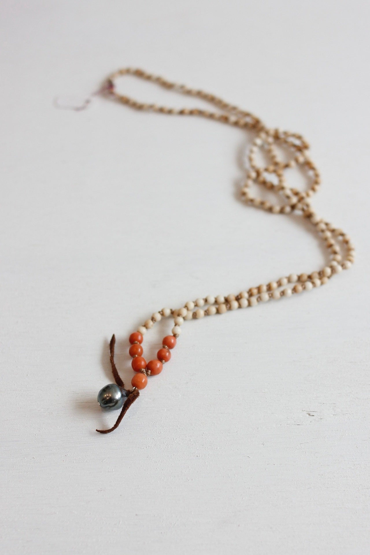 Kate Mcmahon bone and coral necklace with leather and pearl pendant
