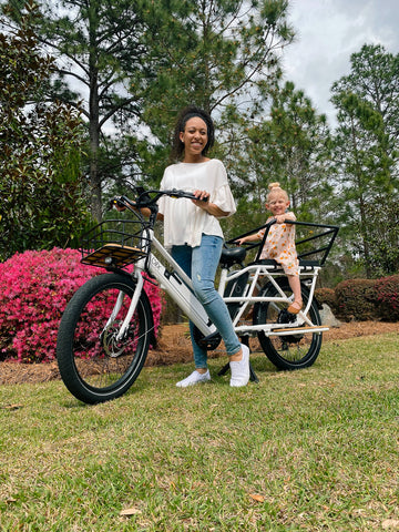 Woman with a child on a White Packa bike