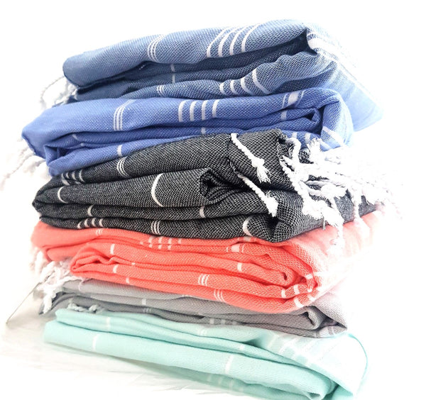 Stack of classic basic beach blankets - the angourie a super sized piece for any adventure