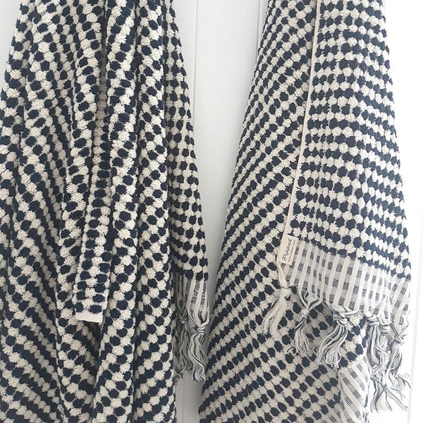A luxurious Turkish towel hand created by skilled artisans - a beautiful result in Navy on Natural - classic