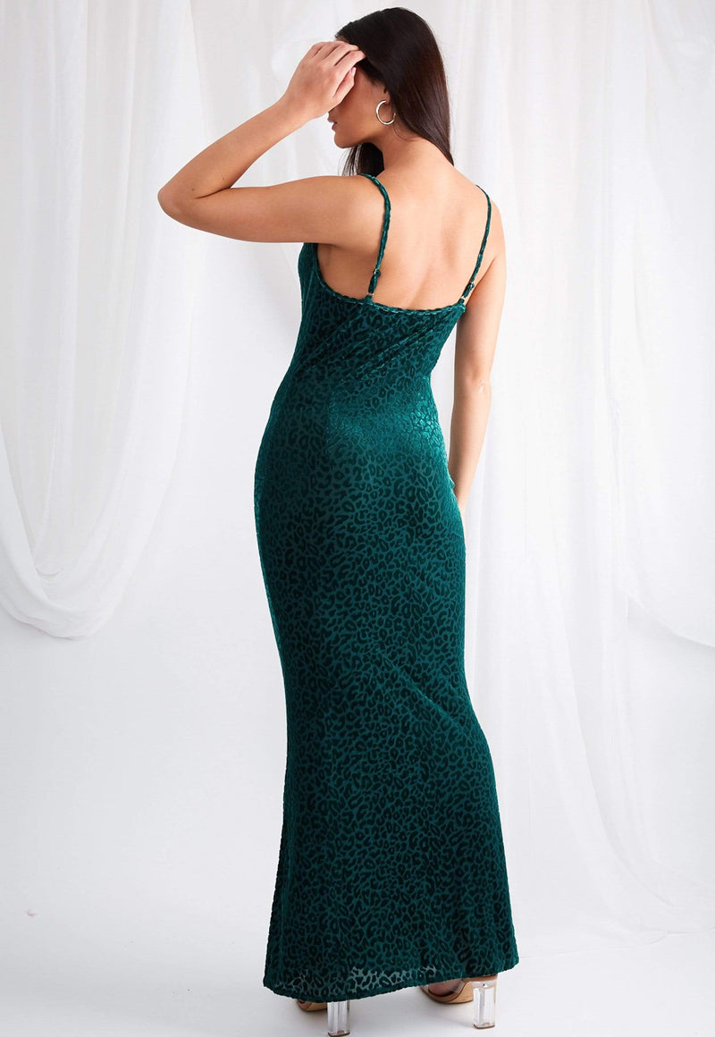 coco boutique, coco boutique maxi dress, green velvet leopard print, green velvet leopard print maxi slip dress, The Keisha Maxi is designed with a flattering cowl neck line and scooped back. Cut from a bright and luxurious emerald green leopard print jacquard. This dress is the perfect addition to your winter occasion-wear  wardrobe