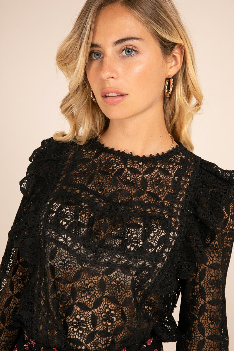 This sweet and simple crochet lace shirt is a stunning choice for classic chic look with impact The statement frill shoulders brings structure to the shoulders, perfect when styled with black denim or leathers. Wear over black or nude bra or cami to make this own, flore, flore shirt  Edit alt text