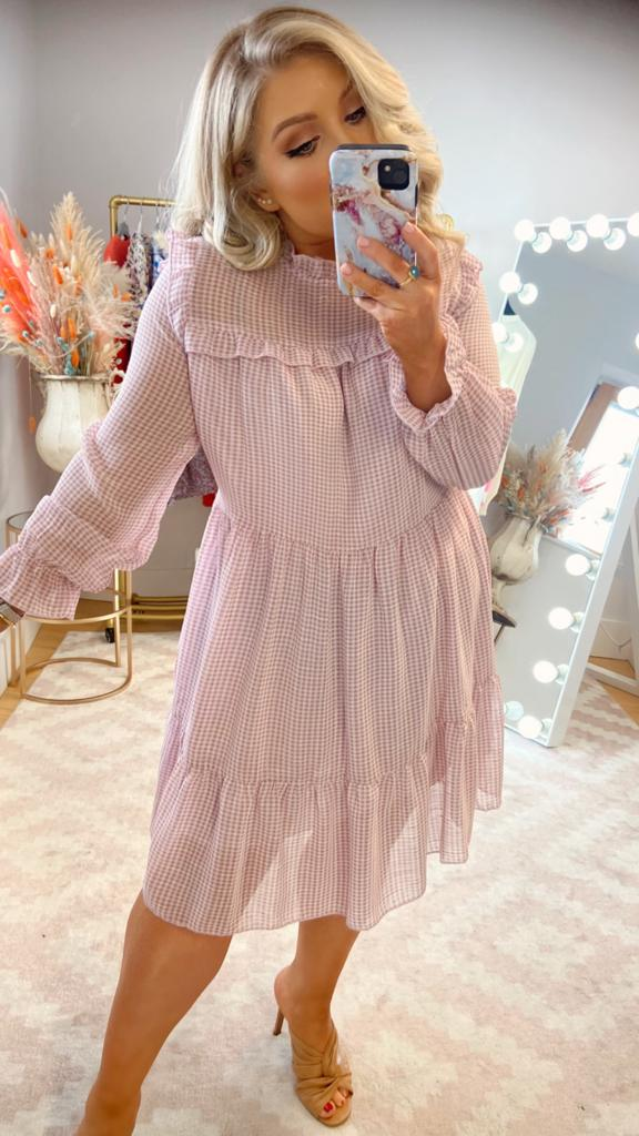 We are just in love with our latest arrival - the Shea silky feel babydoll dress in the most stunning lilac and white check dress!  This silky feel material feels so nice on, and with delicate ruffle shoulder silhouette, 3-tier babydoll body design and the full length sleeve with elasticated wrist - we are dreaming of all the Summer activities we can wear it to!  This dress design comes in a soft flowy material with lilac coloured inner lining; dress up with a heel or dress down with white flats