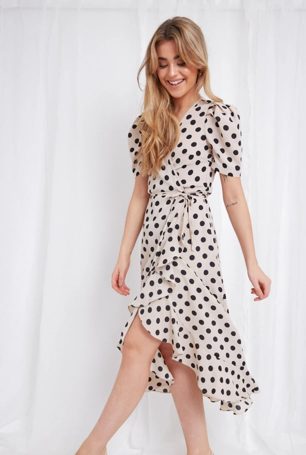 Our Avery Wrap Dress with dots pattern now in offer on Coco Boutique - Order dresses online