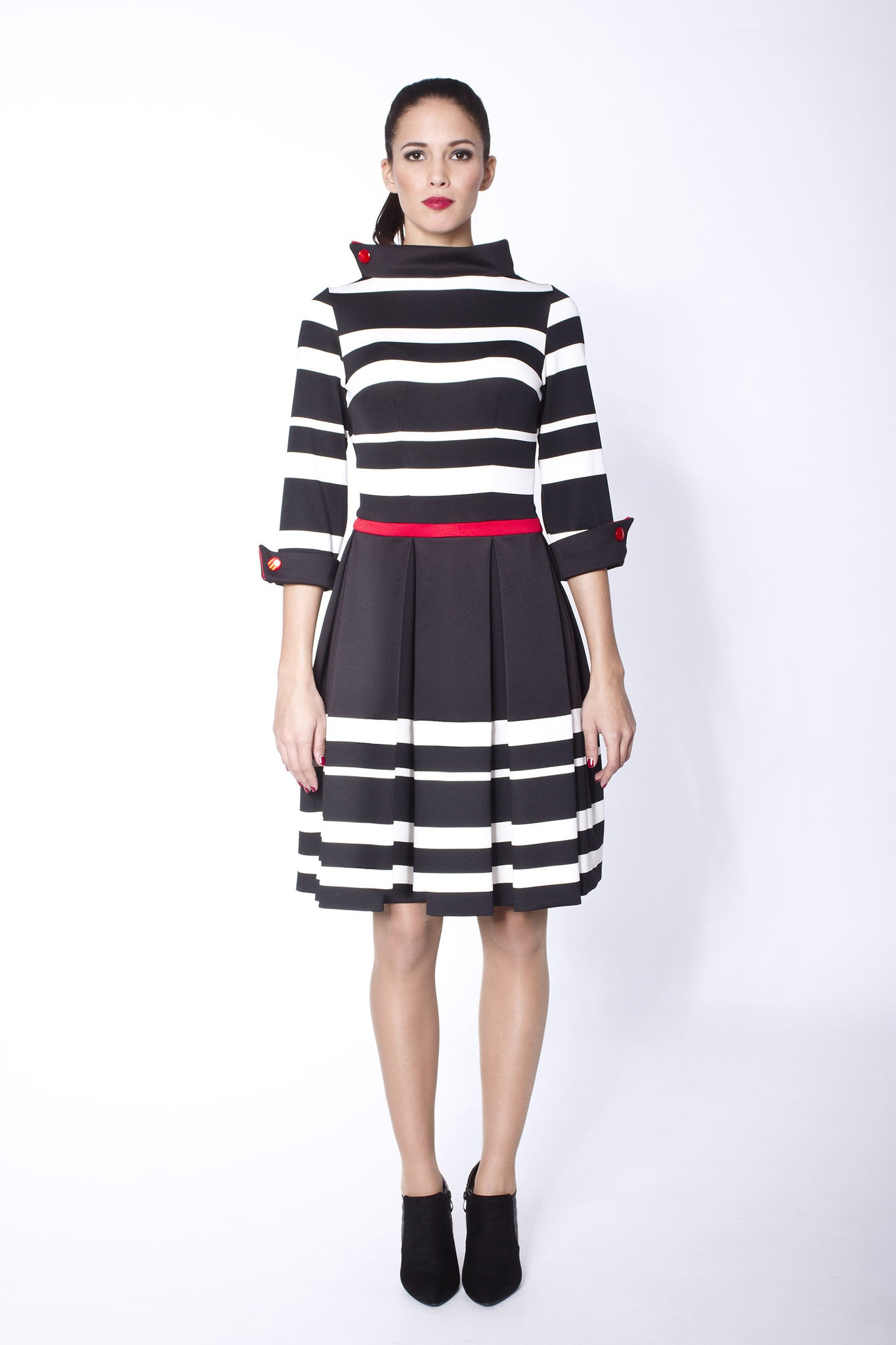 B&W dress with red waistline and red buttons on the collar and the cuffs