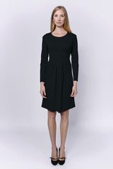 Black long sleeved dress with decorative embellishment