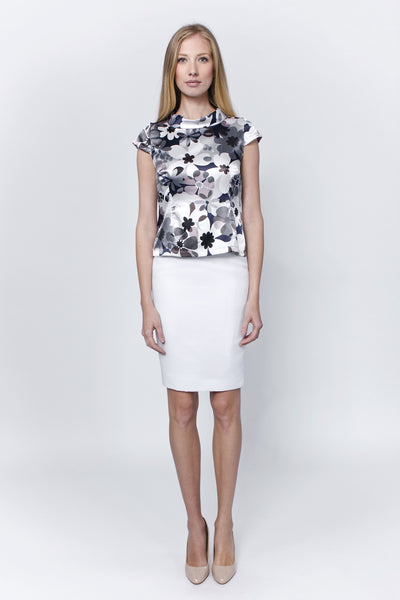 Flowery short sleeved blouse with stand up cowl collar