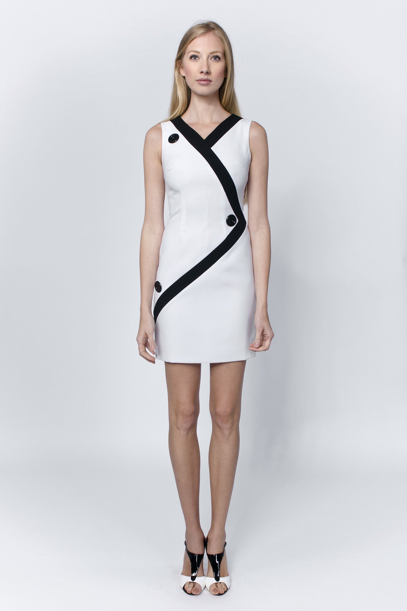 Linea-L-sleeveless-white-dress-embellished-with-black-stripe-and-buttons-Laccafashion-Linea-L