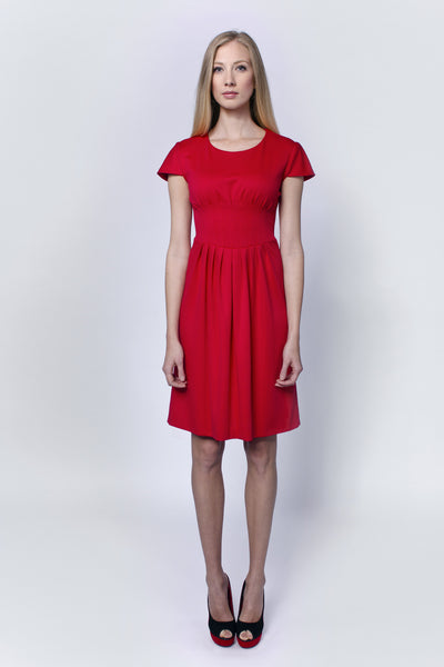 Red dress with sewn embellishments