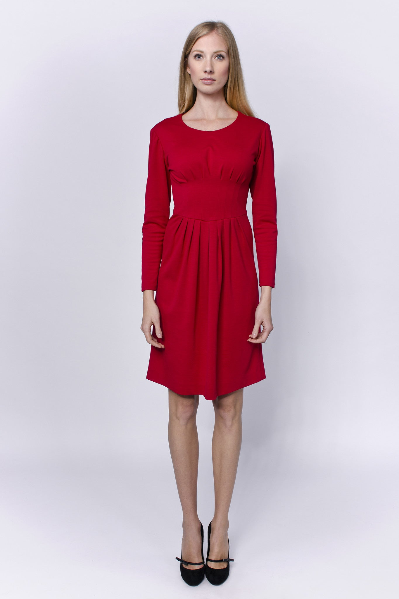 Red, long sleeved dress with sewn embellishments