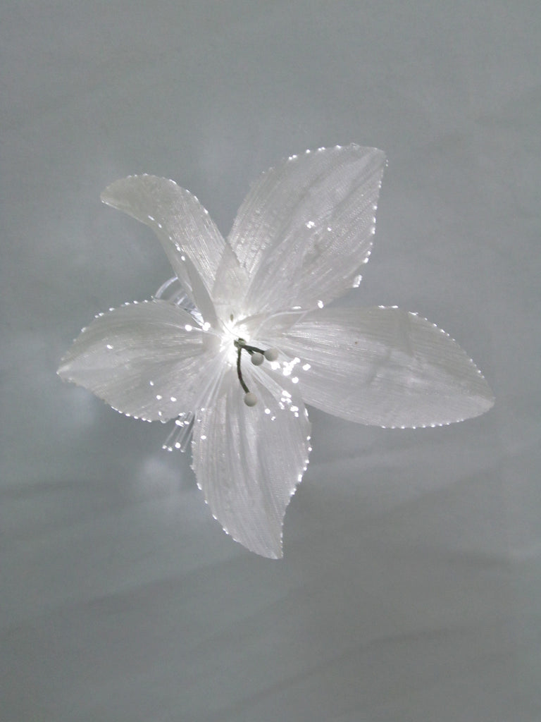 White Lily with White Sparkle Lites® base.  Light up Lily Fiber Optic Flowers. Part of the Sparkle Lites® system.  Lights up in color of LED waterproof Sparkle Base available in pink, blue, green, white, orange, red and color changing. All parts are submersible. Great accent for flowers, centerpieces and crafts.  Perfect for seasonal crafting.