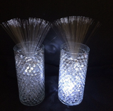 Left vase has a Sparkle Base and Spray, the right vase has a Sparkle Base, riser and Sparkle Spray.