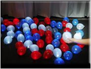 Red White and Blue small mini party balls are balloons with lights that fit in the palm of your hand