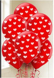 red with white heart balloon