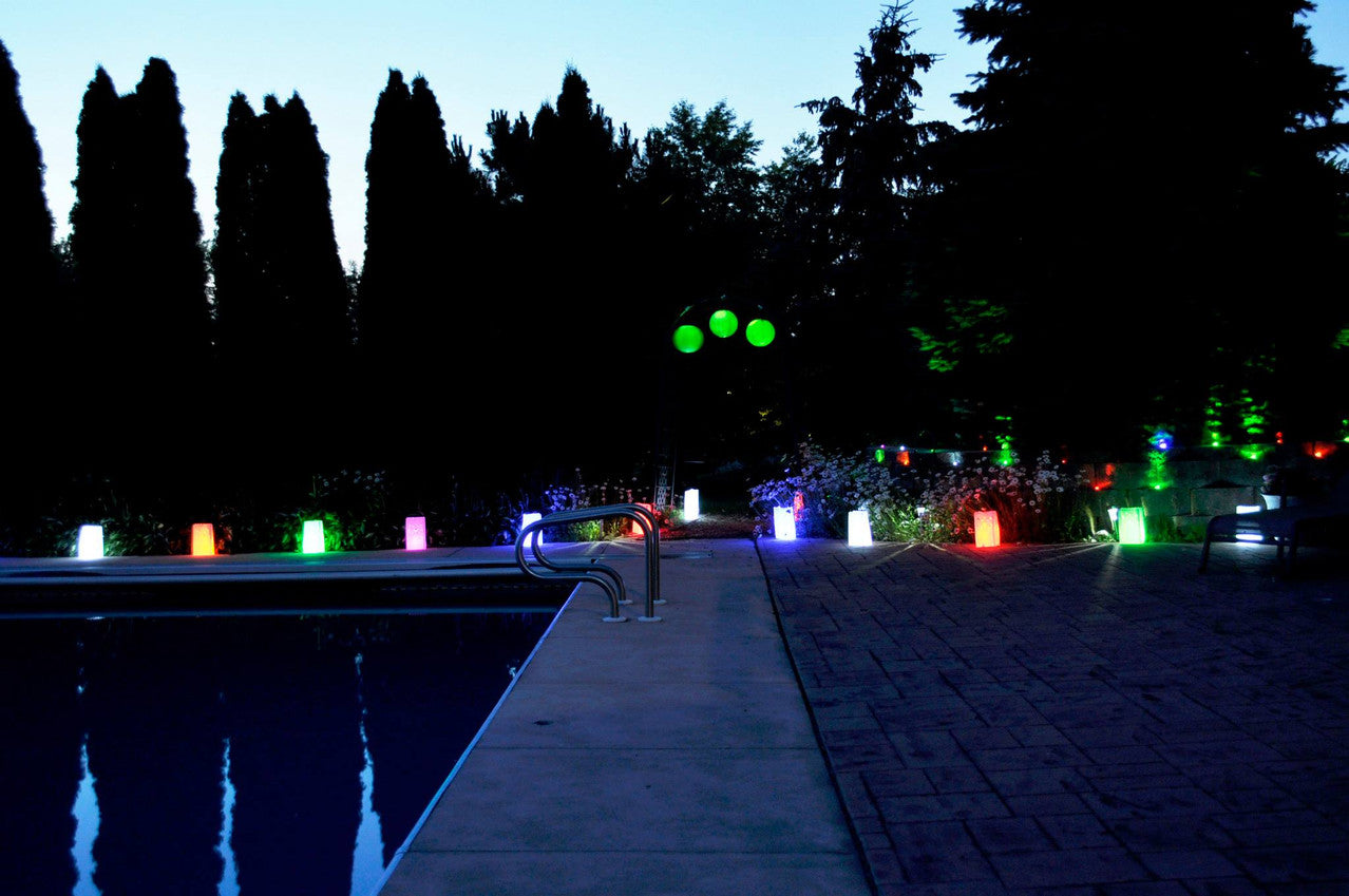 Sparkle Lites, Sparkle Ribbon and Party Dots in Luminary Bags, Lanterns and as wireless landscape lighting for a party.  Affordable and versatile outdoor party decorations