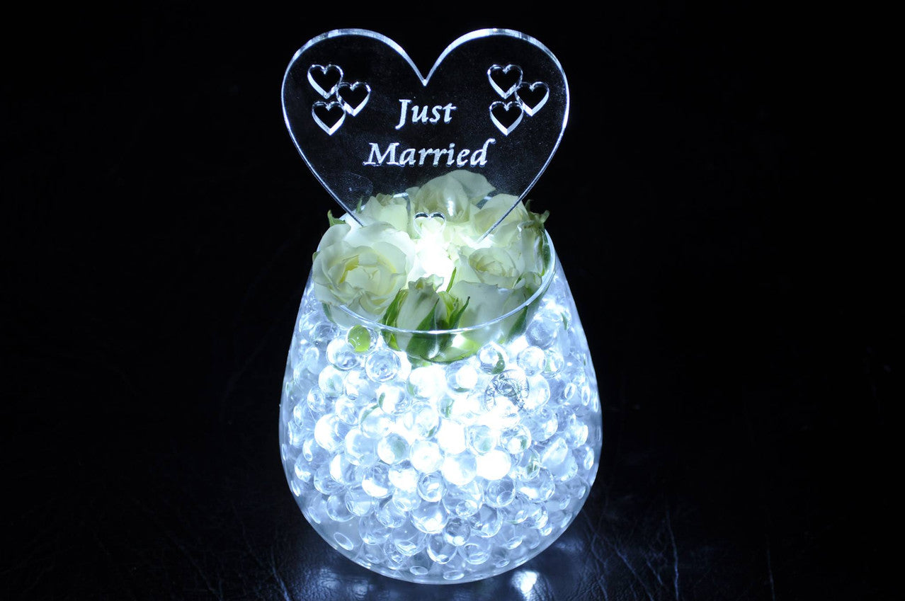 Sparkle Lites Just Married Acrylic Head in water beads and a vase. Simple light up wedding centerpiece. Very affordable DIY wedding project