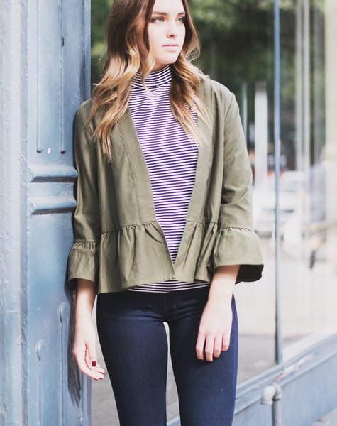 ruffle jacket with a striped mock neck top