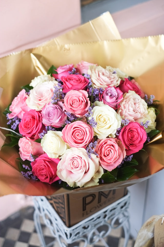 Inspired by Harry & Meghan's wedding this large london bouquet features a mix of 24 summery roses and limonium.