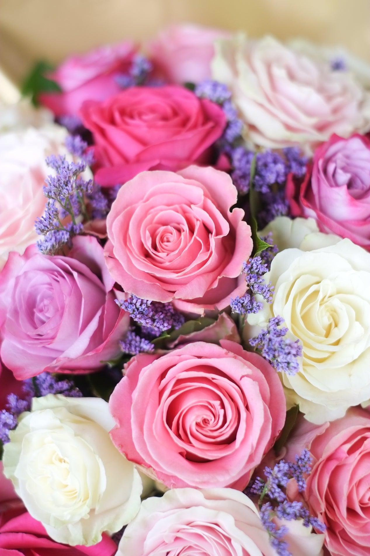 Close up of royal bunch bouquet wedding this large bouquet features a mix of 24 summery roses and limonium.