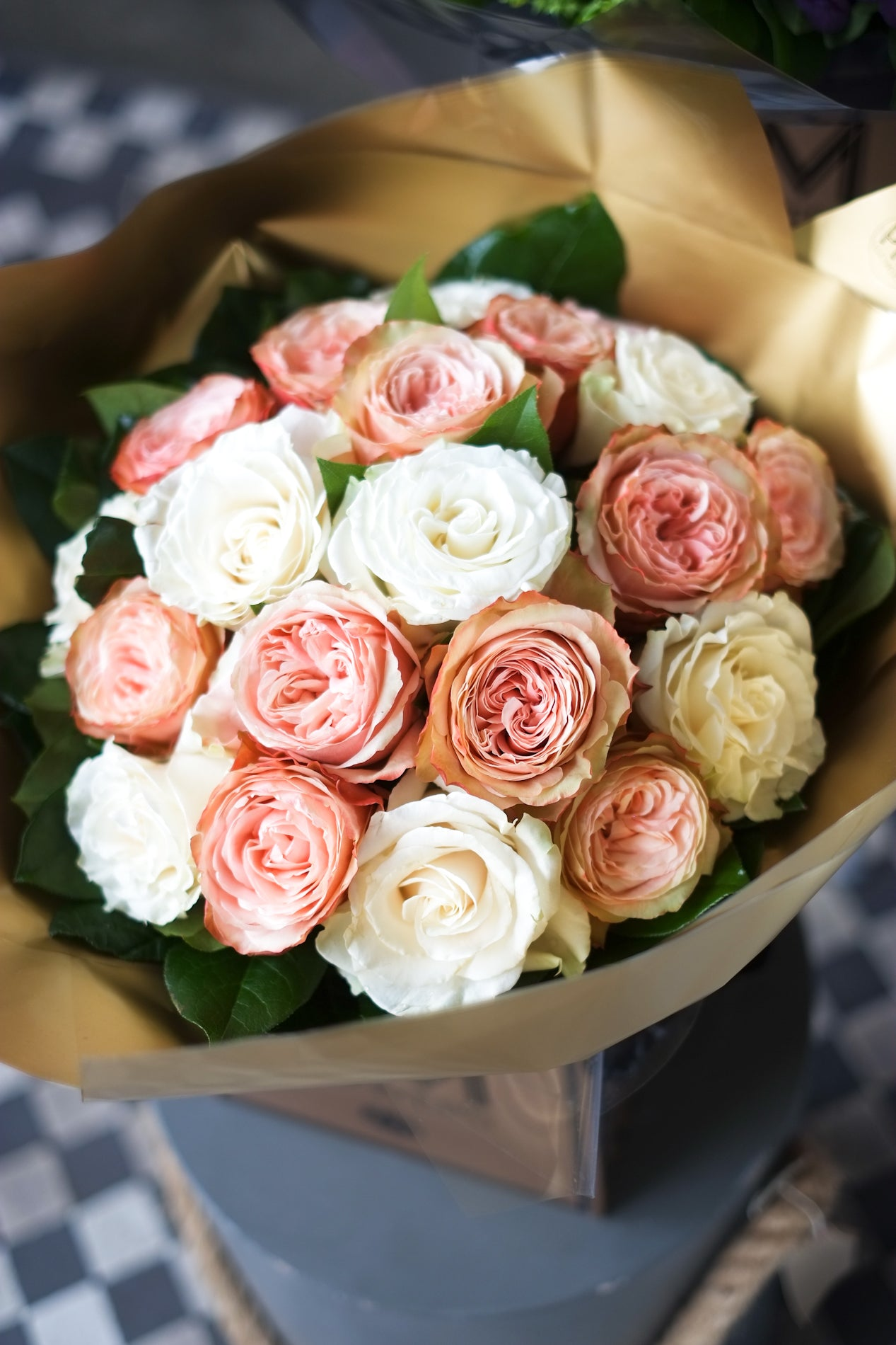 White velvet flowers in London. Bouquet is elegant and sophisticated bouquet combines premium White roses with an exquisite champagne-cream-powder-peach rose