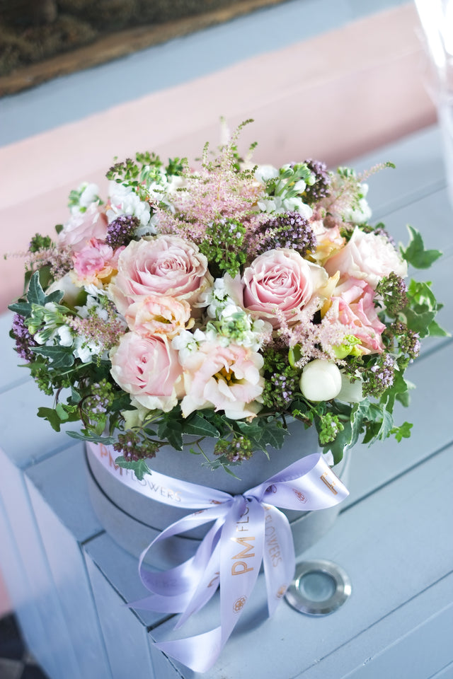 Summer floral Hatbox of blush pink Roses, Lisianthus, Stock, Astilbe, Ivy and Oregano herbs creating a subtle summery aroma.