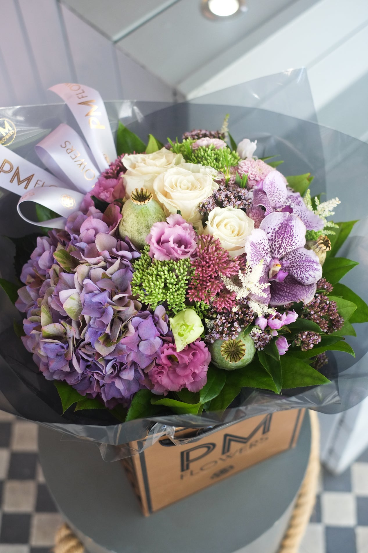 Bohemian bouquet flowers is A beautiful harmonizing combination of Hydrangeas, Roses, Orchids, Poppys, Oregano and complimenting foliages.