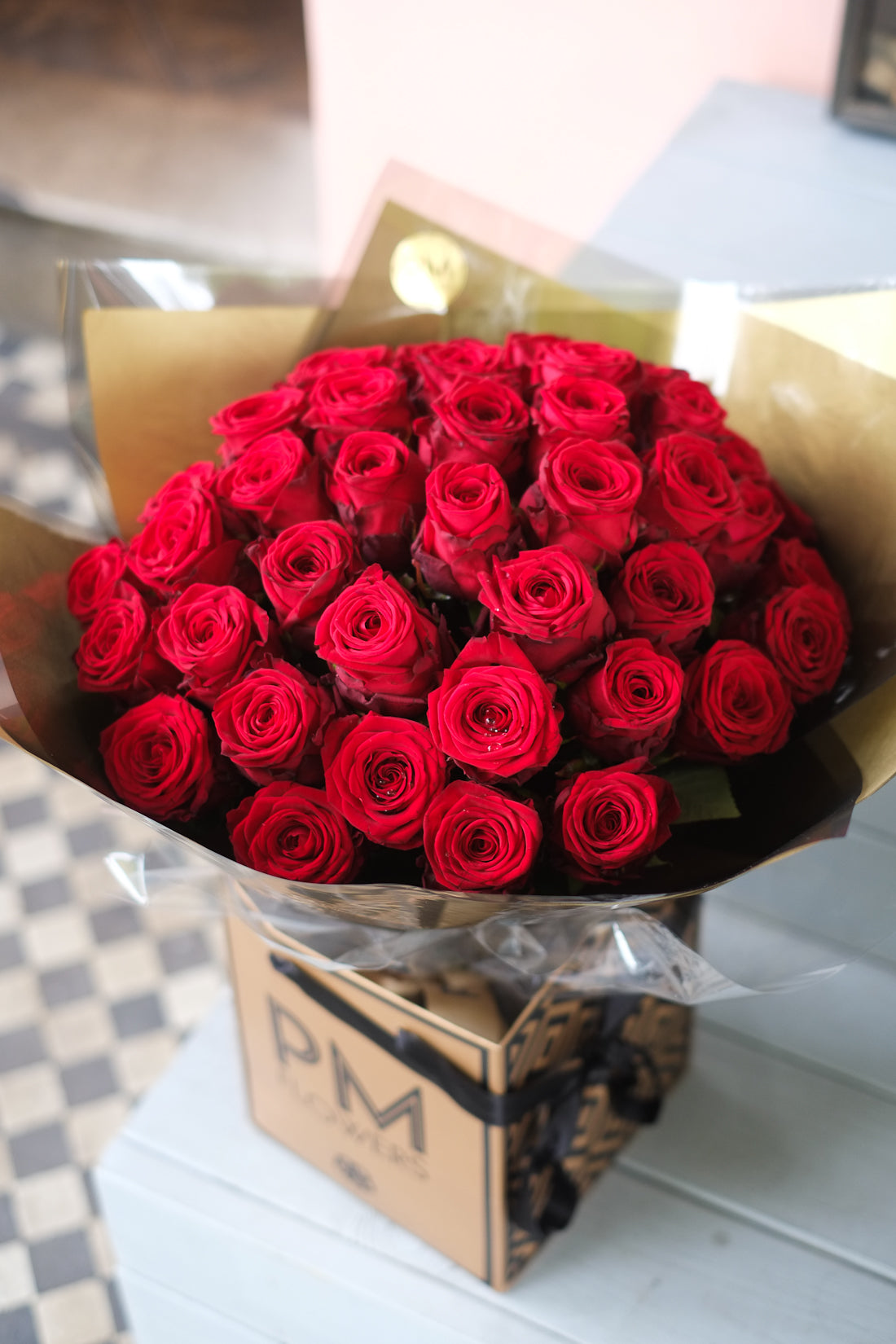Red roses bouquet features  large headed premium red roses.