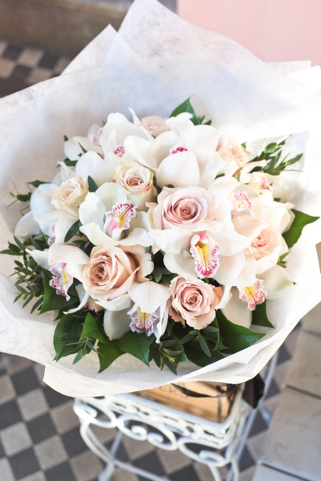 A beautiful flower bouquet of silk-like sand rose accompanied with white cymbidiums brings a strikingly elegant bouquet.
