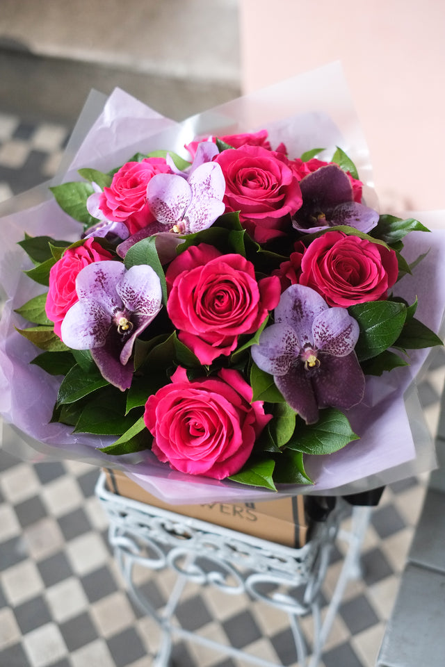Flower Bouquet of large cerise pink roses and lavender/aubergine orchids. Delivery in London