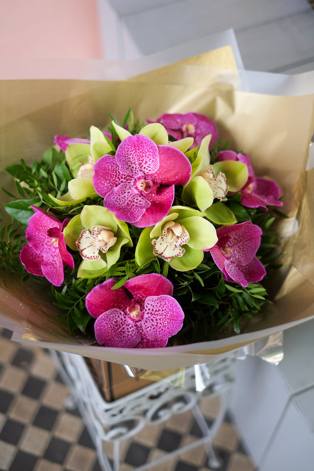 A bouquet of Cerice Vanda and Green Cymbidium