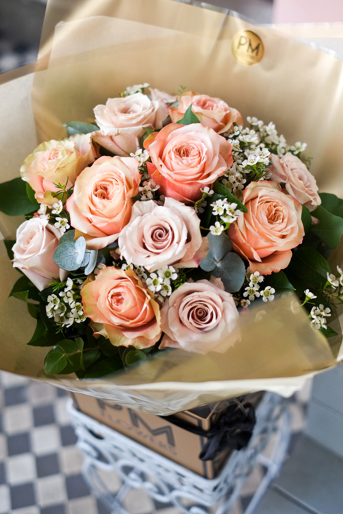 A simple yet lavish bouquet. Combination of stunning sand and peach roses with white waxflower. Delivery in London