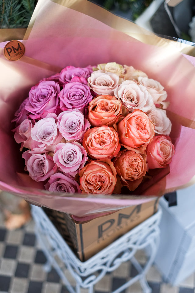 Inception flower bouquet is a wonderful clash of colour, with 4 types of large headed roses combined offering a lavish glow to your world.